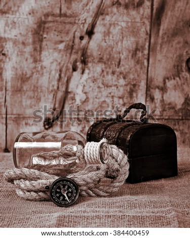 vintage chest and compass - stock photo