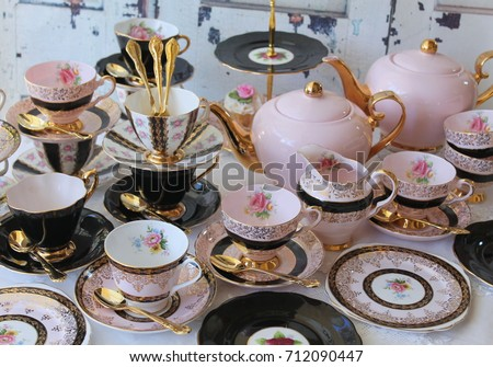 Vintage chic pink and black teacup sets cake stand teapots and gold cutlery flatware & Vintage Chic Pink Black Teacup Sets Stock Photo (100% Legal ...
