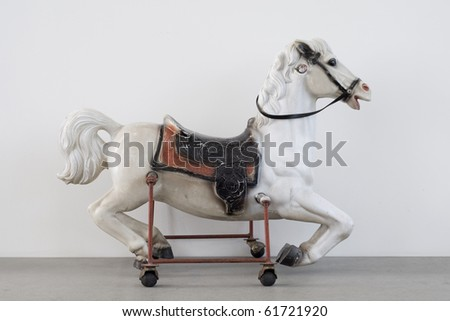Vintage Children horse riding toy isolated on white background - stock photo