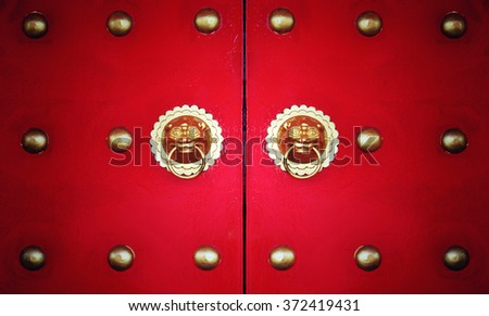 Vintage chinese door with vignette and filter effect - stock photo