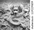 Vintage Chinese stone dragon statue - stock photo