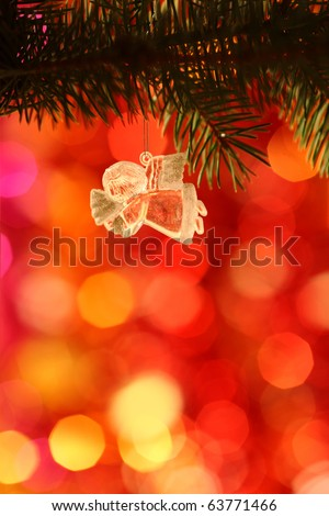 Vintage Christmas Angel against light blurred background - stock photo