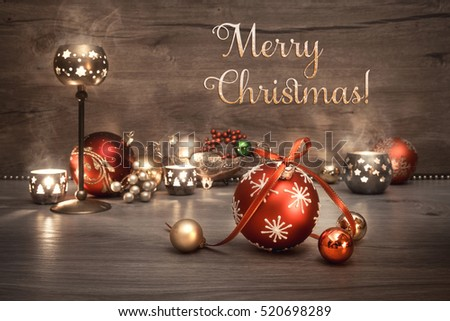 "Vintage Christmas background with candles and Christmas baubles, text ""Merry Christmas!"". This image is toned. Shallow DOF, focus on the front baubles."