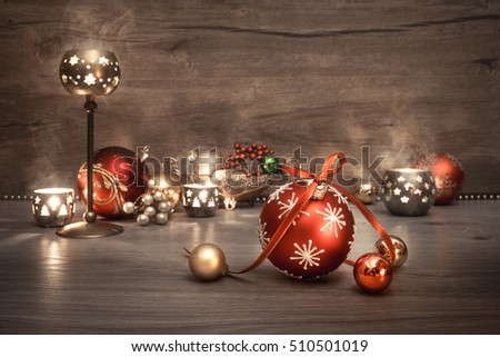 Vintage Christmas background with candles and Christmas baubles, text space. This image is toned. Shallow DOF, focus on the front baubles.