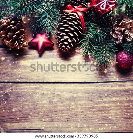 Vintage Christmas background with Christmas decoration. Christmas card with present box, pine cone, fir tree and balls with copy space for  greeting text - stock photo