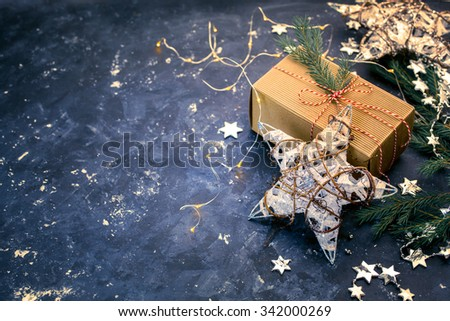 Vintage Christmas background with  Christmas Gift on a dark background. Shallow DOF - stock photo