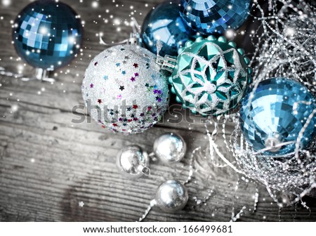 Vintage Christmas background with snow and Christmas decoration/ christmas decorations on old wooden background - stock photo