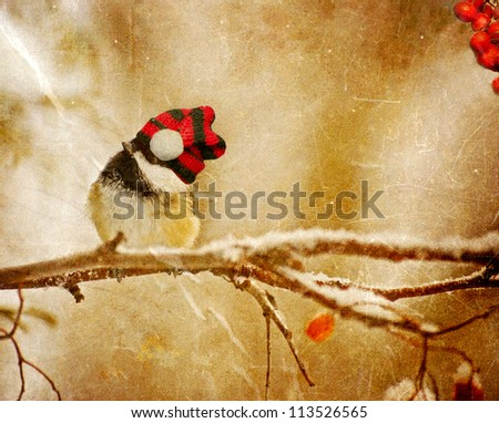 Vintage Christmas card with an adorable chickadee in the snow with copy space. - stock photo