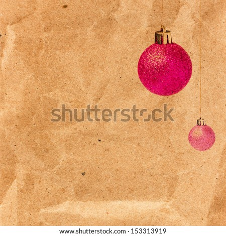 Vintage Christmas card with glittering balls on old recycled brown paper  with copy space. Christmas decoration over grunge vintage paper background. - stock photo