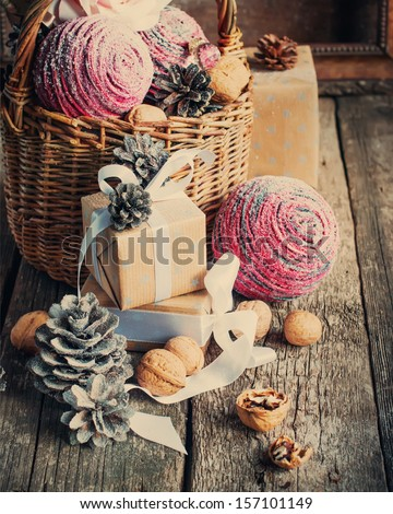 Vintage Christmas Composition with box, basket, pine cones, nuts and walnuts  - stock photo