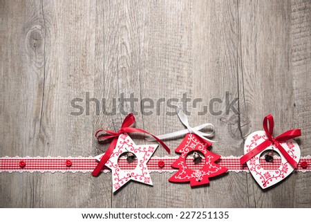 Vintage christmas decoration on old wooden background - stock photo