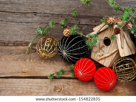 vintage christmas decoration over rustic wooden background. red and black china style balls and baubles - stock photo