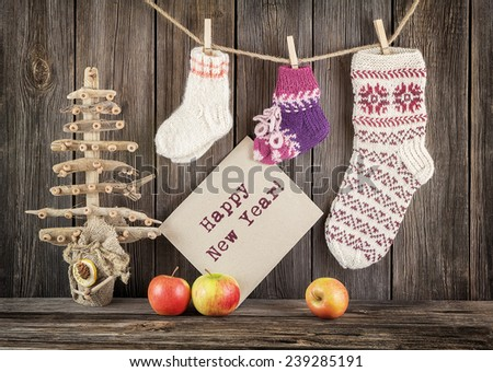Vintage Christmas decoration with a socks and apples - stock photo