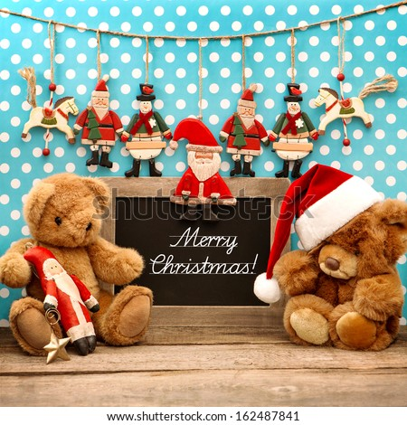 vintage christmas decoration with antique toys. retro style home interior blackboard with sample text Merry Christmas - stock photo