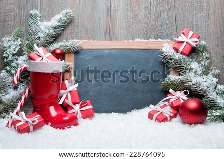 Vintage Christmas decoration with chalkboard for message - stock photo