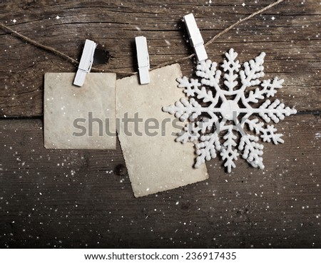 Vintage Christmas decorations and and empty cards with copy space hanging on clotheslines  - stock photo