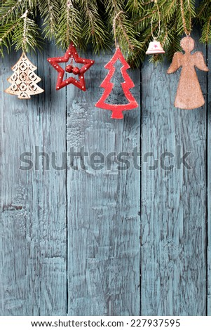Vintage christmas decorations on old wooden background vertical - stock photo