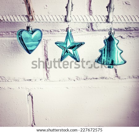 vintage christmas decorations over white wall - stock photo