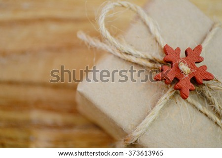 Vintage Christmas gift box on old wooden background.