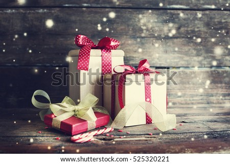 Vintage christmas gift boxes on wooden background/ holidays gift background