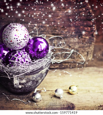 Vintage Christmas Ornament Background/ Christmas decorations in old pot on textured wooden background/ Composition with Brilliant Christmas Balls - stock photo