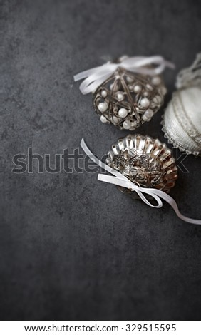 Vintage Christmas ornaments on a rustic  background - stock photo
