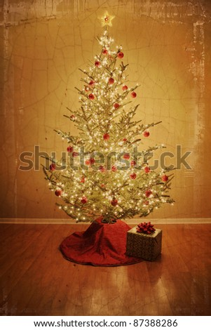 Vintage Christmas tree with red ball ornaments and present - stock photo