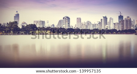 Vintage City at night with reflection - stock photo