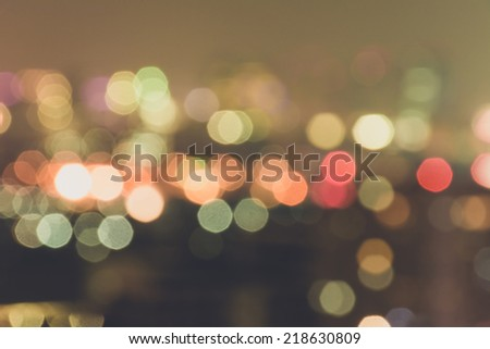 Vintage city light blur bokeh, defocused background. - stock photo