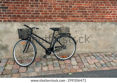 Vintage Classical  Black Bicycle in front of an old house Denmark                                - stock photo
