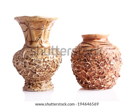 Vintage clay vases isolated on white - stock photo