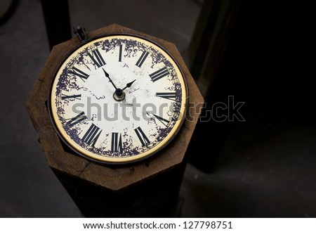 Vintage Clock against Dark Brown Background