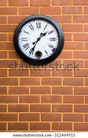Vintage Clock analog and red brick Wall background. - stock photo