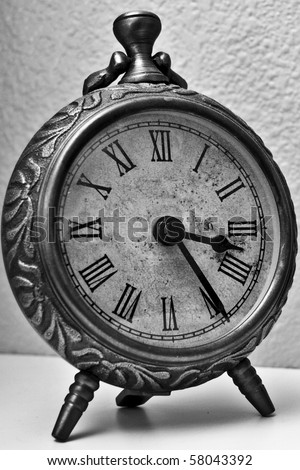Vintage clock in black and white - stock photo