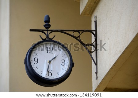 Vintage Clock On A Building Wall - stock photo