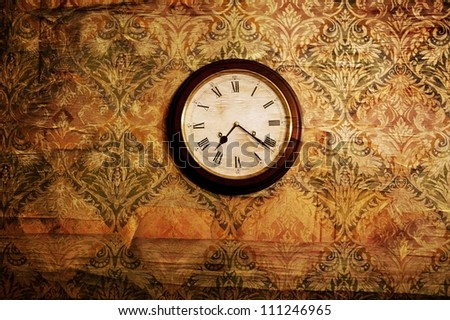 Vintage clock on a wall - stock photo