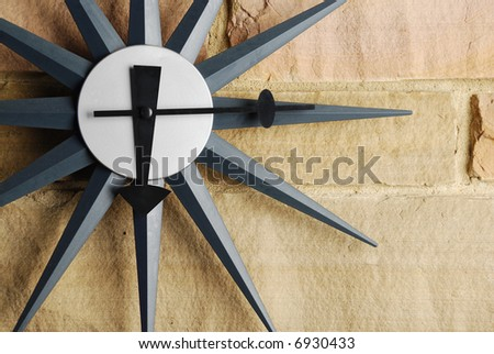 Vintage clock on modern stones - stock photo