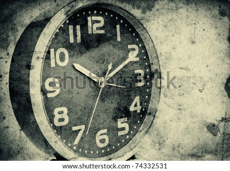 Vintage clock over a grunge paper background