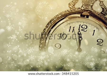Vintage clock showing midnight on sparkling holiday background - stock photo