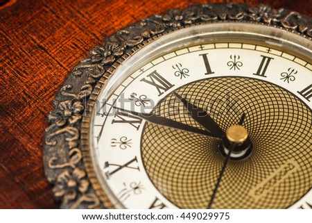 Vintage clock showing time about twelve  - stock photo