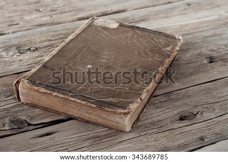 Vintage closed book on wooden background closeup - stock photo