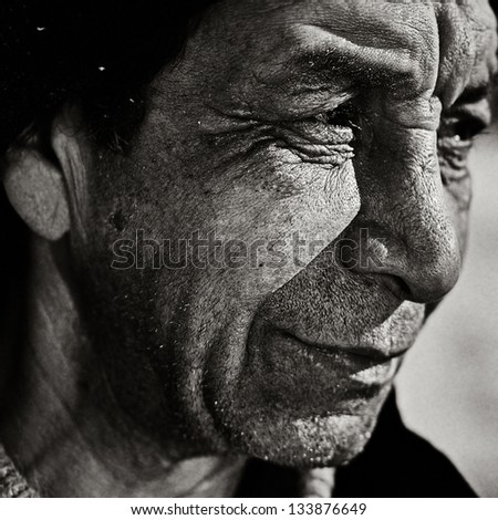 Vintage closeup portrait of senior man with wisdom smile - stock photo