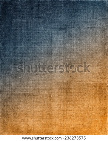 Vintage cloth with a blue to orange screen pattern and grunge background textures.  Image displays a strong grain texture when viewed at 100 percent. - stock photo