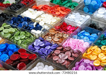vintage clothes buttons with variety color on sell in market - stock photo