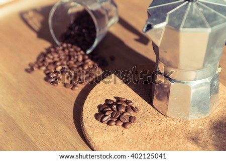 Vintage coffee maker pot on old wooden table top - stock photo