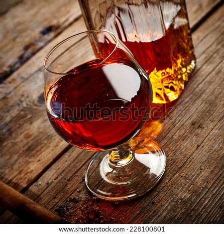 Vintage cognac still life on wooden background - stock photo