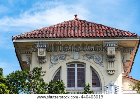Vintage Colonial Cuban house with tiled roof. Many old mansions like these are left standing and preserved as heritage sites. - stock photo