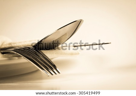 vintage color of close up dinning the silverware fork , spoon and knife with dish on white background and text space - stock photo