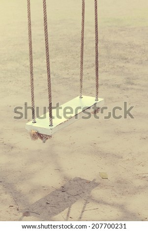 Vintage color of rope swings white wooden. - stock photo