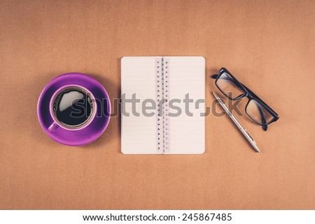 Vintage color. Office table with notepad, computer and coffee cup. View from above with copy space.View from above - stock photo